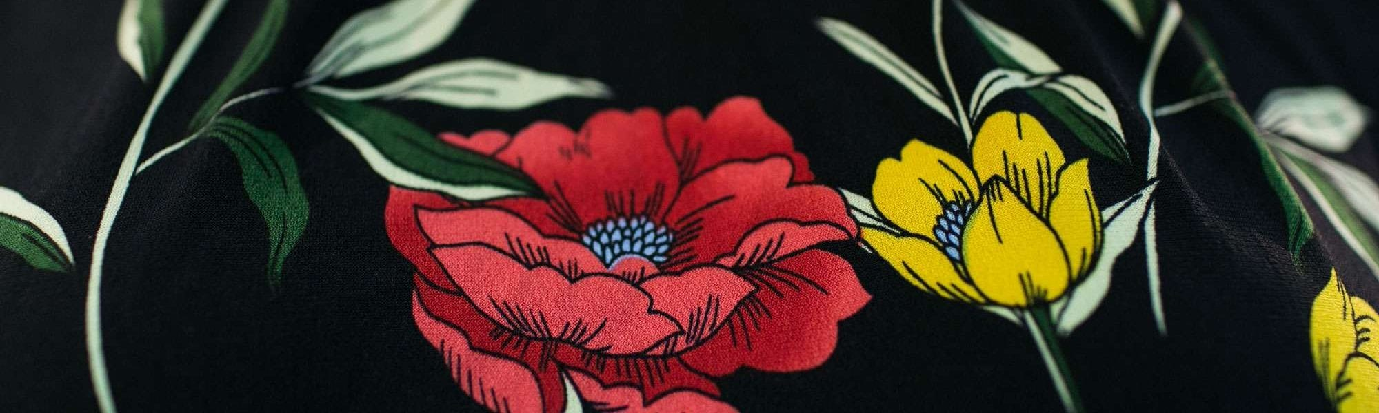 red and yellow flowers on black fabric