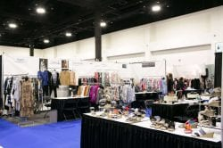 vendor booth full of clothing and shoes