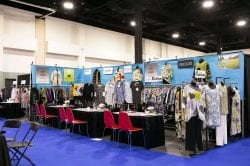 vendor booth full of colorful clothing