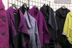 rack of purple womens coats