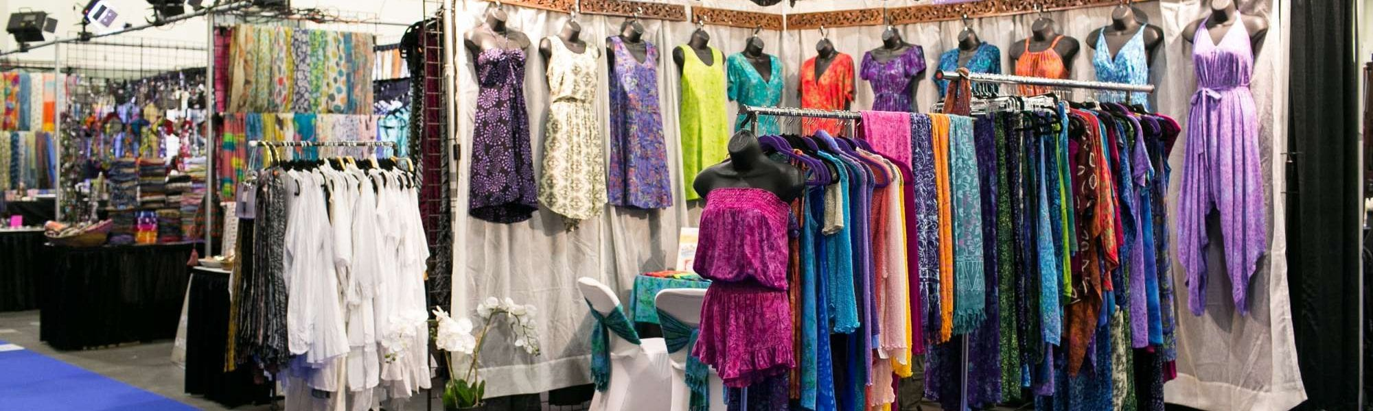 vendor booth full of brightly colored dresses