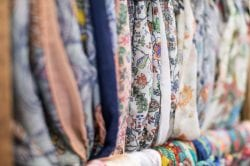rack of colorful scarves
