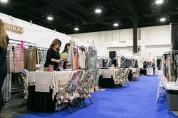 two women working in apparel booth