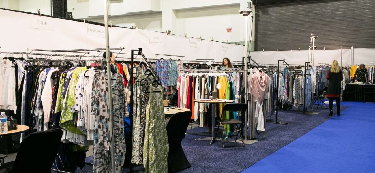 clothing racks set up at a trade show