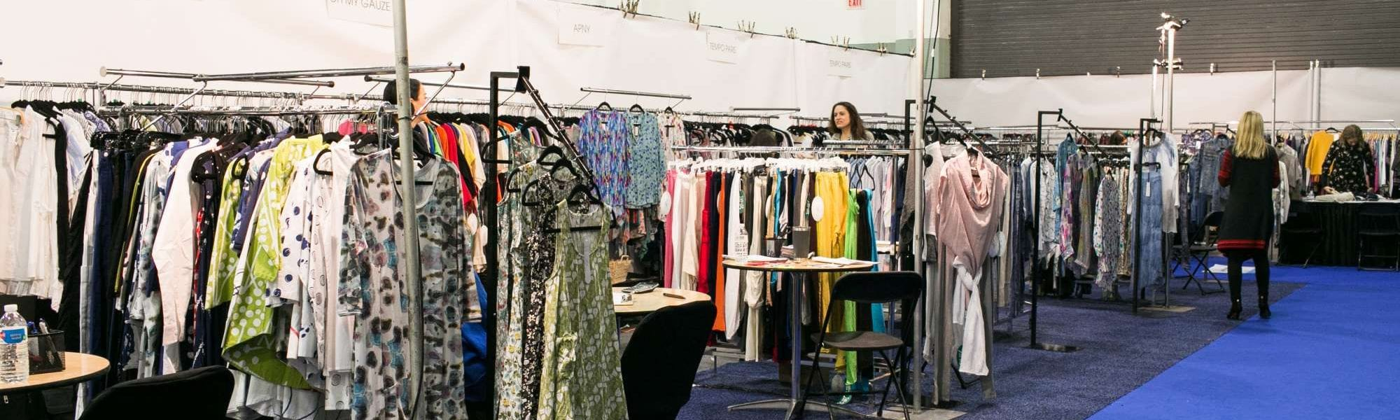 clothing racks set up at a trade show
