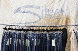 Silver jeans hanging on a clothing rack