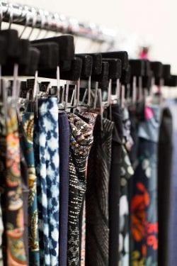 colorful leggings on a clothing rack