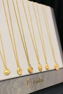 M Kindred gold necklaces with gold pendants
