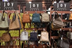 Joy leather purses and backpacks on display