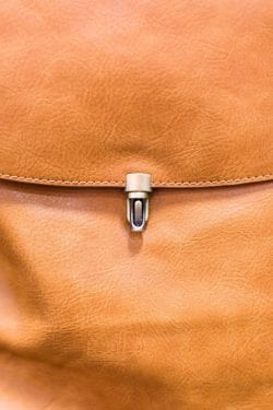 detail of a brown leather purse clasp