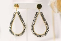 drop earrings that are gold with silver beads