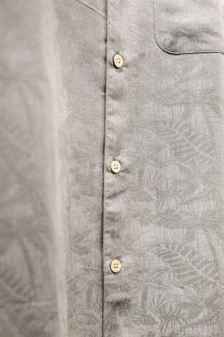 a close-up of a men's grey button down shirt