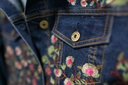 jean jacket detail with embroidered flowers