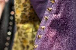 purple leather detail with gold studs