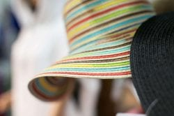 a close up of a colorful straw hat