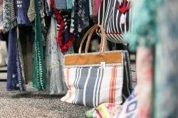 striped canvas handbag sitting on the floor