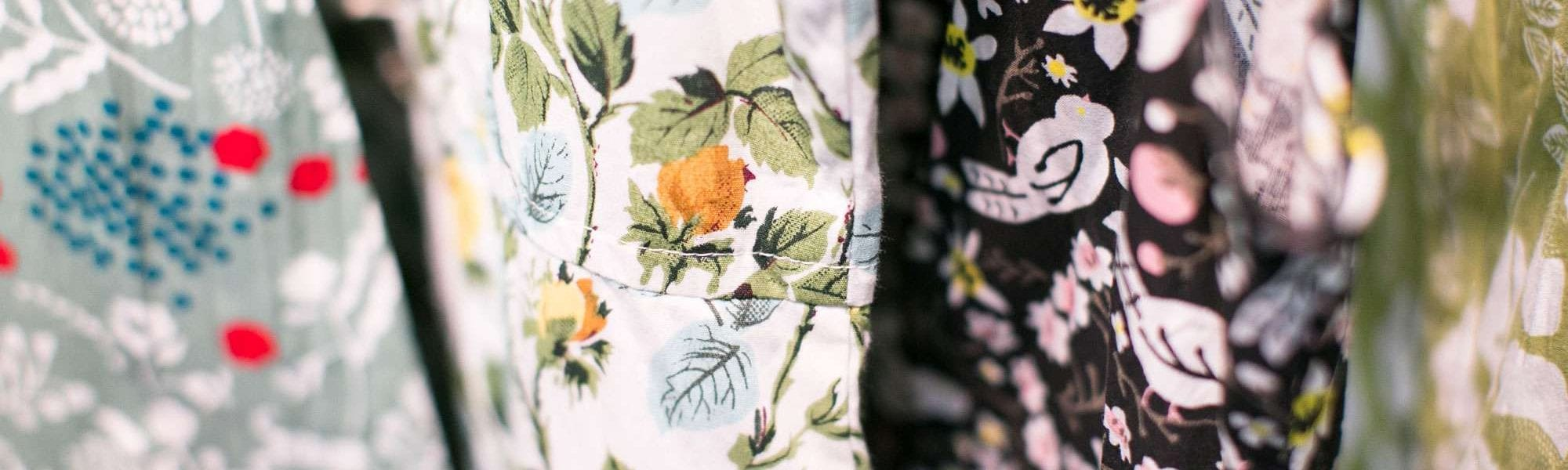 a close-up of four different flower patterned fabrics